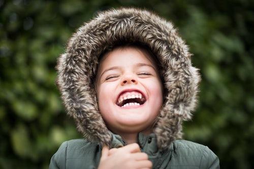 Child smiling showing nice teeth before he needs orthodontics Glasgow